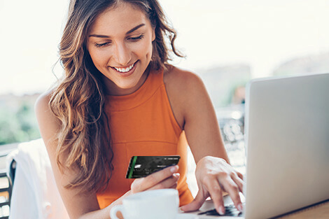 woman using her credit card to make an online purchase