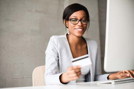 Business executive making purchase online with credit card
