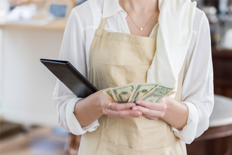Business owner holding cash