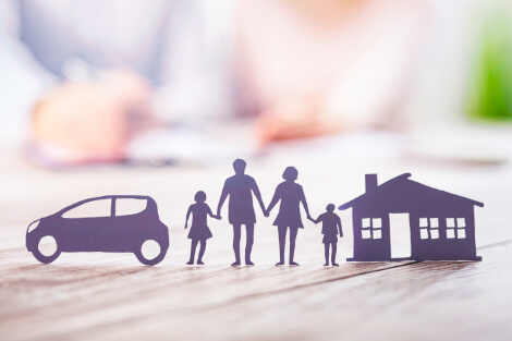 paper cut out of family, house and car