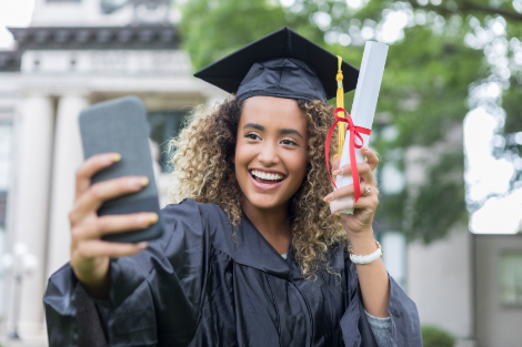 MBA students taking a selfie on graduation day