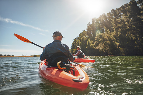 retired couple kayaking together