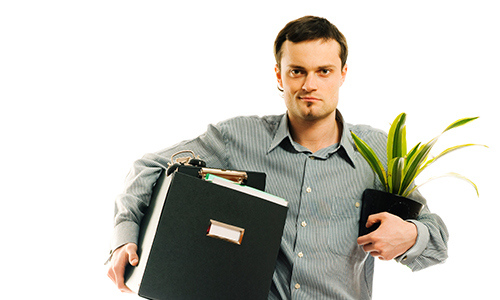 A man carrying his files and plant.