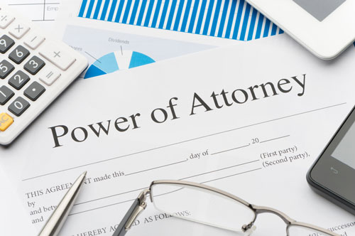 Power of attorney paperwork sitting on a desk