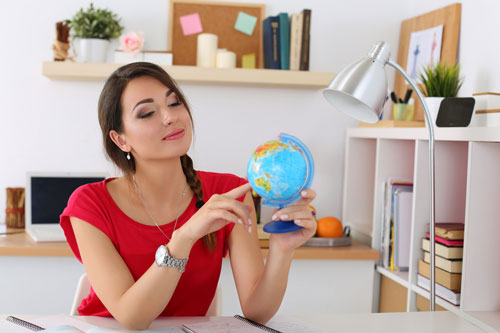 Woman looking at a globe