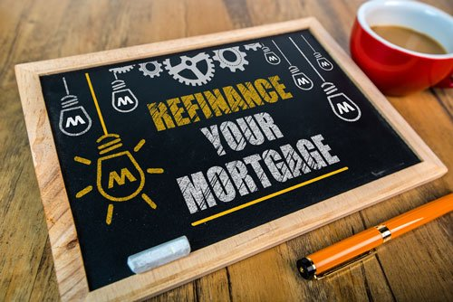 A chalk board with the message refinance your mortgage