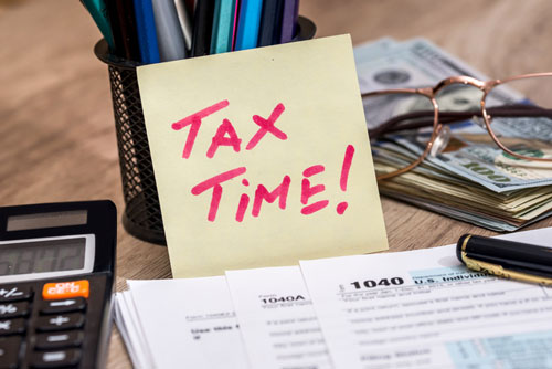 "Post-it reading: ""tax time"""