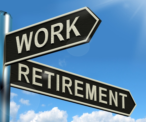A road sign with the words work and retirement pointing in different directions